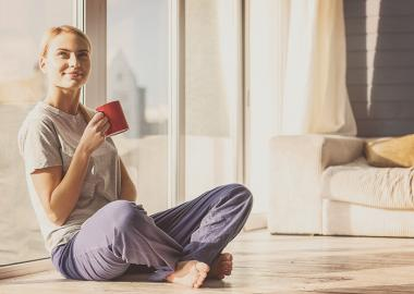 lady drinking coffee on house on floor